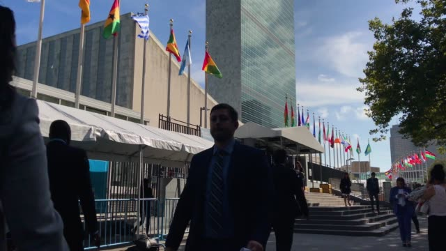 people walk past the united nations headquarters on september 26 2018 in new york city world leaders gathered for the 73rd annual meeting at the un... - 国際連合点の映像素材/bロール