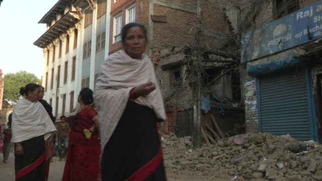 People walk the street in hard hit Bhaktapur / A major earthquake hit Kathmandu midday on Saturday April 25th and was followed by multiple...