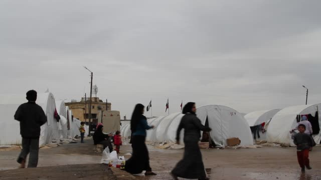 people walk through a bab alsalam syrian refugee camp near in azaz syria on the border with turkey - syria stock videos & royalty-free footage