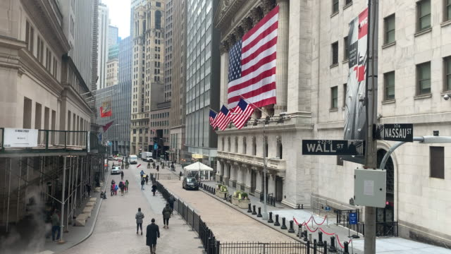 people walk through a midtown manhattan shopping district on march 17, 2020 in new york city. schools, businesses and most places where people... - wall street lower manhattan stock videos & royalty-free footage