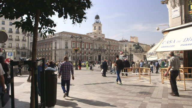 People walk through a public square in Madrid, Spain.