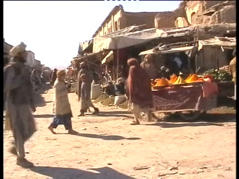 people walk through an afghan market - spice stock videos and b-roll footage