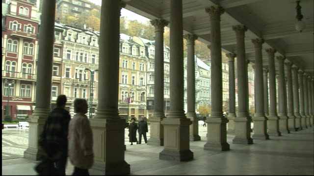 people walk through colonnade - colonnade stock videos & royalty-free footage