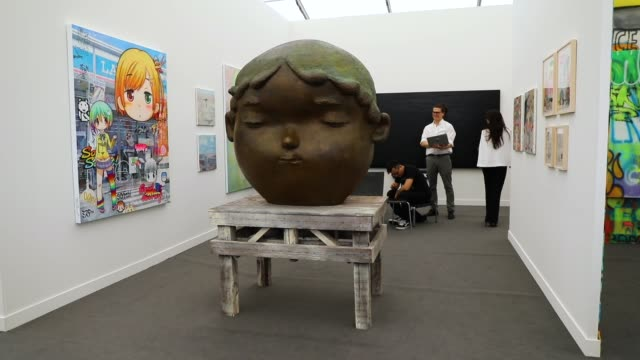 people walk through exhibits at the new york frieze art fair on on may 3 2018 in new york city held on randalls island a short water taxi car or bus... - fries säulengebälk stock-videos und b-roll-filmmaterial