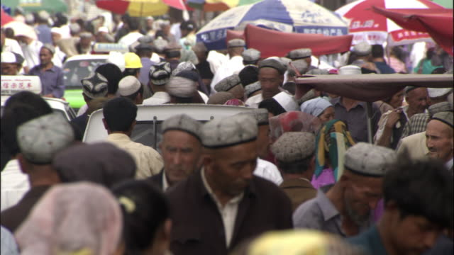 people walk through kashgar market, xinjiang province, china - xinjiang province stock videos & royalty-free footage
