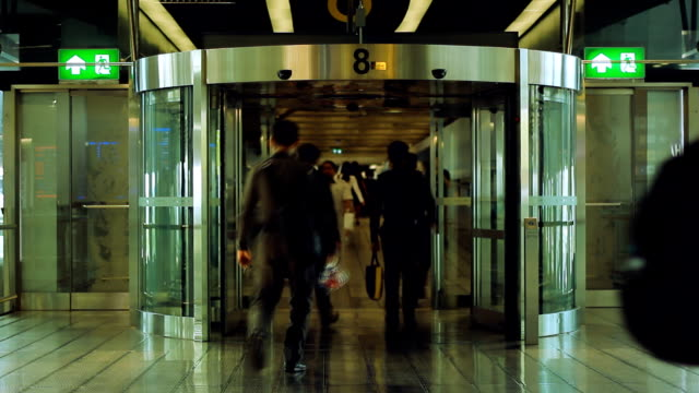 people walk through revolving door at airport - information sign stock videos & royalty-free footage