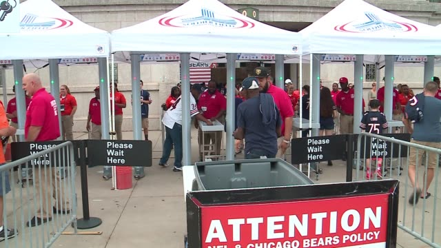 vidéos et rushes de people walk through security check point, metal detectors at soldier field before bears game in chicago on september 19, 2016. - nfc
