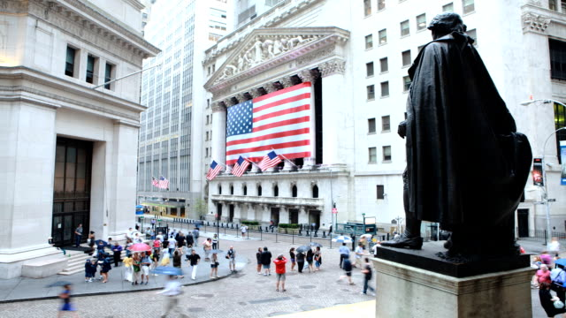 people walk through the financial district in new york city. - new york stock exchange bildbanksvideor och videomaterial från bakom kulisserna