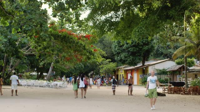 ms people walk through the quadrado in trancoso / trancoso, brazil - porto seguro stock videos & royalty-free footage