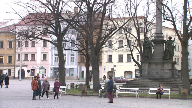 people walk through town plaza - stare mesto stock videos & royalty-free footage