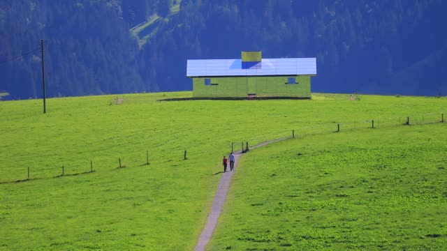 "people walk towards ""mirage gstaad"" by los angeles-based artist doug aitken is on display outside as installation sculpture representing a chalet... - kaleidoscope pattern stock videos & royalty-free footage"