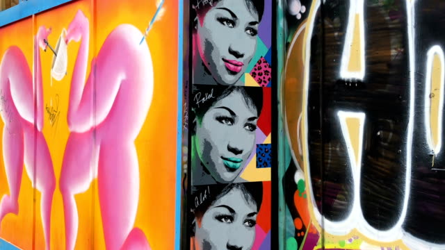 people walk towards murals of the images of the late aretha franklin in the east london shoreditch area on august 23 2018 in london england the... - pancreatic cancer stock videos and b-roll footage