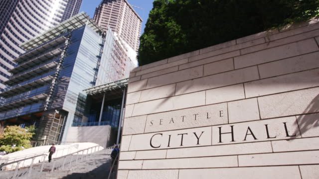 People walk up stairs to Seattle City Hall