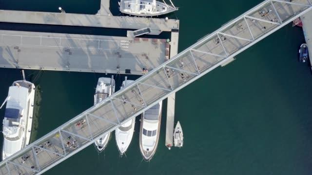 people walking across an elevated walkway - footbridge stock videos & royalty-free footage