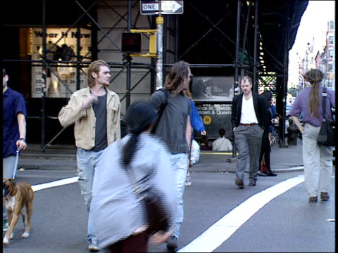 people walking across broadway at prince street - broadway manhattan stock videos and b-roll footage