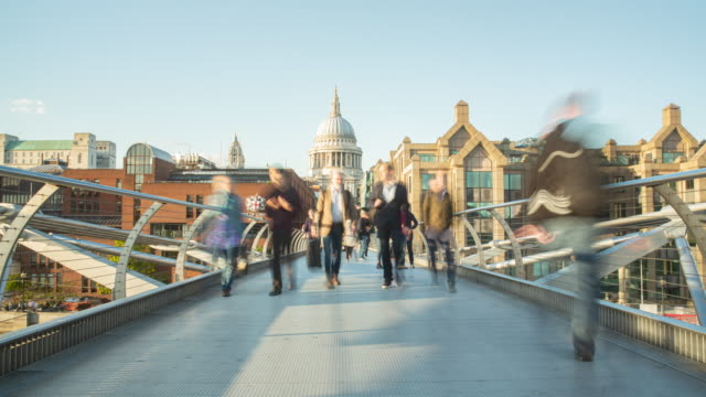 people walking across millenium bridge with st paul's cathederal in the background - suspension bridge stock videos & royalty-free footage