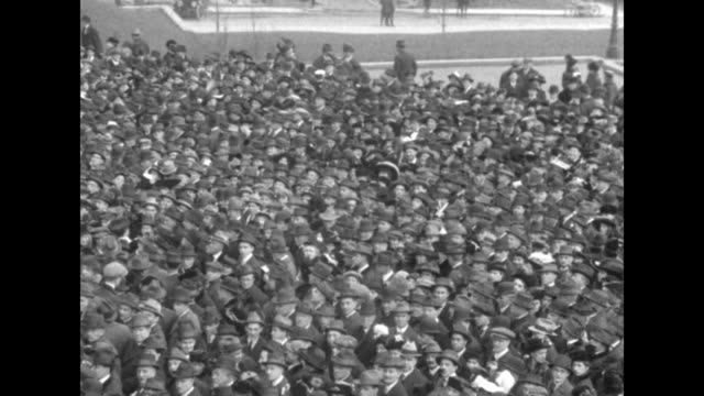 people walking / aerials large crowd waiting / president woodrow wilson and several men wearing top hats standing next to a train men in bowlers... - top hat stock videos & royalty-free footage