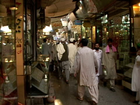 ms people walking along alley with stores, kabul city, kabul, afghanistan - kabul stock-videos und b-roll-filmmaterial