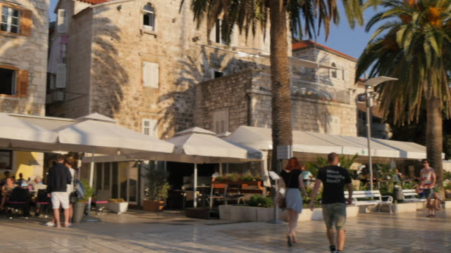 People walking along harbourside promenade, Hvar, Hvar Island, Dalmatia, Croatia, Europe