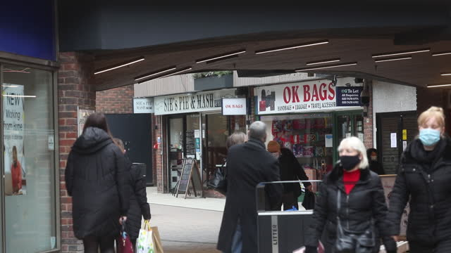 people walking along stores, as tier 3 restrictions come into force, in chatham, medway, kent, england, u.k., on wednesday, december 2, 2020. medway... - shopping bag stock videos & royalty-free footage