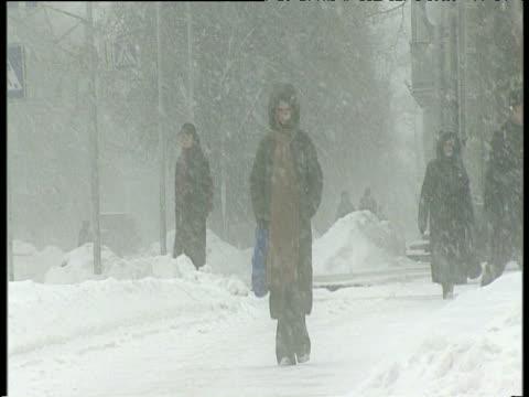 people walking along streets in heavy snow ukraine - ukraine stock videos & royalty-free footage