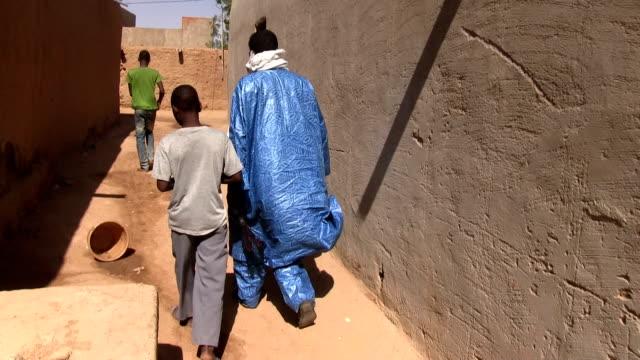 People walking along the street Niger Agadez