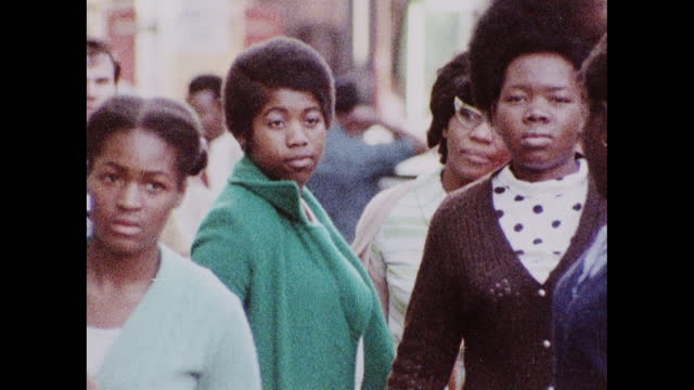 people walking along the streets in 1970s brixton - afro hairstyle stock videos & royalty-free footage