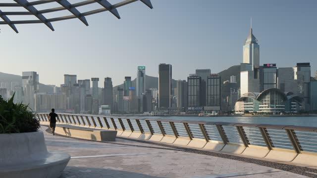 stockvideo's en b-roll-footage met people walking along tsim sha tsui promenade, hong kong, china, asia - hong kong