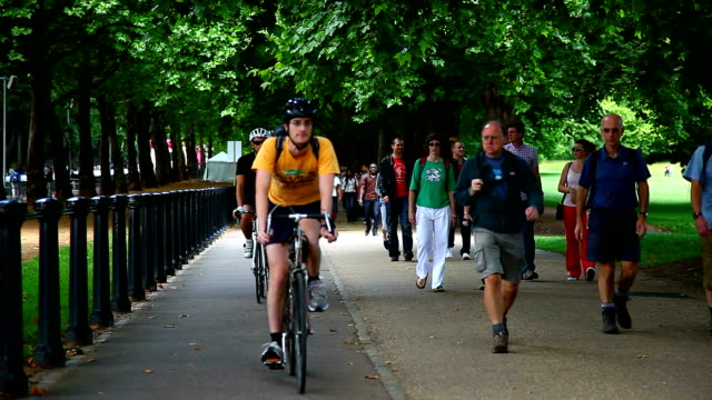 people walking and cycling in the hyde park, london - hyde park london stock videos & royalty-free footage