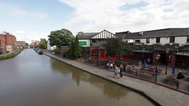 ms pan people walking and enjoying at bank of river / chester, england - chester england stock videos and b-roll footage