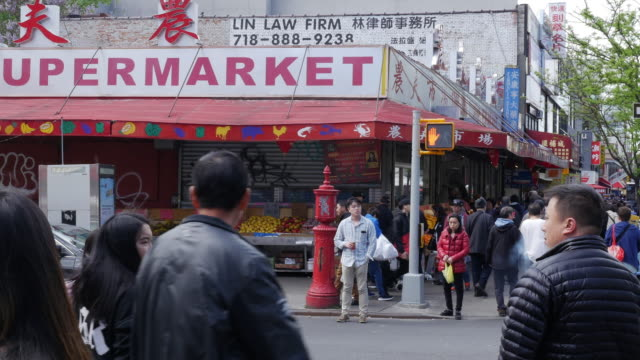 people walking and shopping in flushing, queens, new york city - flushing queens stock videos and b-roll footage