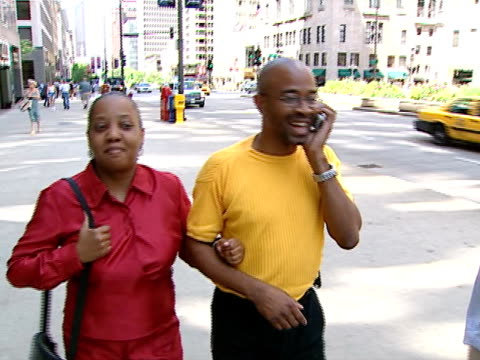 people walking and talking on cell phone on michigan avenue on july 1, 2001 in chicago, illinois. - 2000 stock videos & royalty-free footage