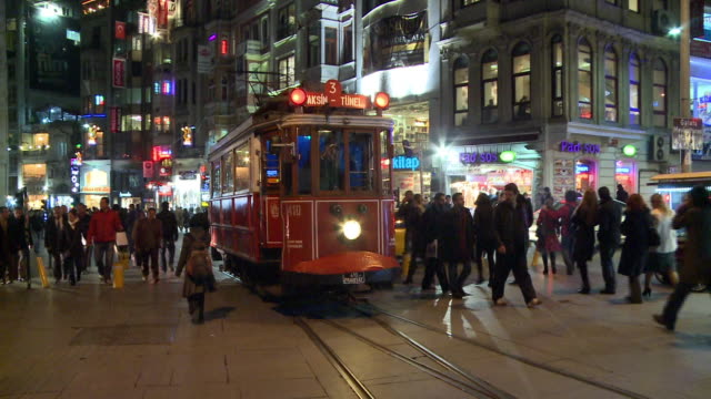 People walking and tram passing in Istanbul, Turkey