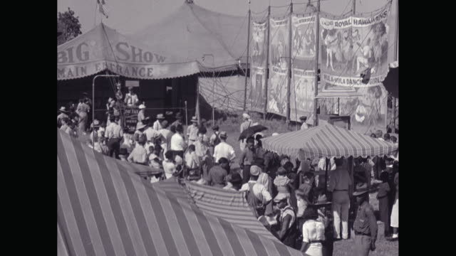 WS HA People walking around at sideshow in circus / United States