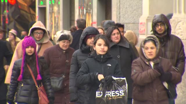 people walking around downtown chicago in the winter on december 24 2013 in chicago illinois - mitten stock videos and b-roll footage