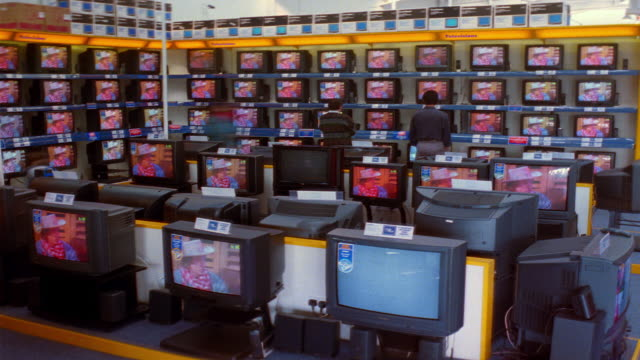 t/l, ms, people walking around electronics shop - electrical shop stock videos & royalty-free footage