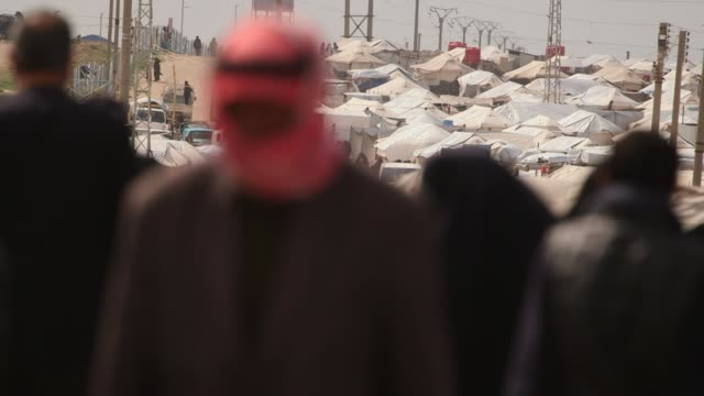 People walking around inside Al Hawl internment camp in Syria after the collapse of the Islamic State
