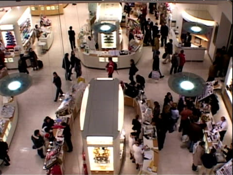 people walking around make-up counters in london department store - department store stock videos & royalty-free footage