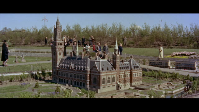 ms people walking around miniature dutch city - figurine stock videos and b-roll footage