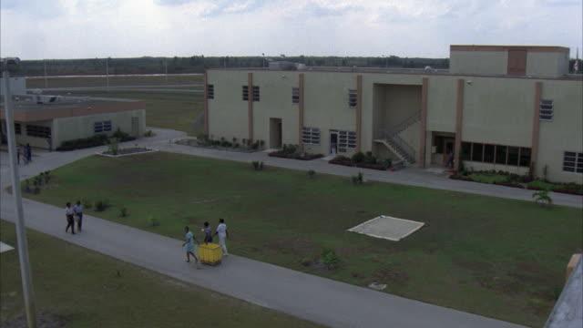 ha, pan, people walking around prison buildings, usa - women prison stock videos & royalty-free footage