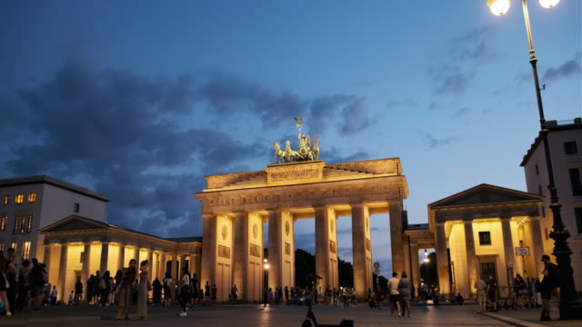 people walking around the brandenburg gate, germany at night - germany stock videos & royalty-free footage
