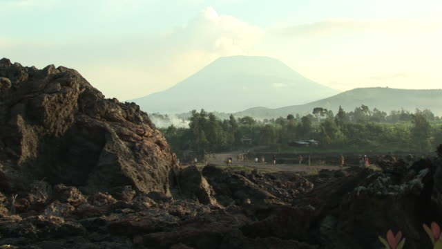 People walking around the valley, vulcano at background