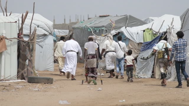 people walking at a displaced peoples camp in yemen - yemen stock videos & royalty-free footage