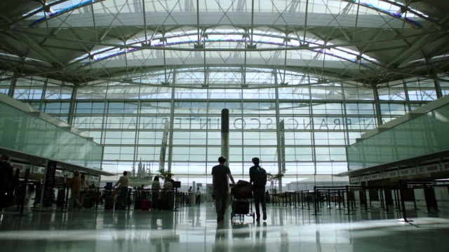 ws tu people walking at airport departure area in sfo - gate stock videos & royalty-free footage