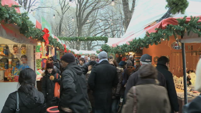 ms people walking at columbus circle market during christmas / new york city, new york, usa - christmas shopping stock videos and b-roll footage
