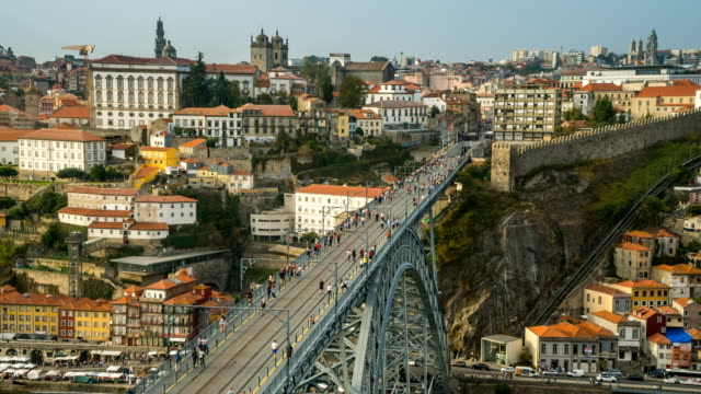 t/l people walking at dom luís i bridge, porto, portugal - porto district portugal stock videos & royalty-free footage