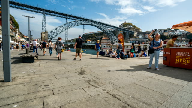 t/l people walking at dom luís i bridge, porto, portugal - ancient civilisation stock videos & royalty-free footage