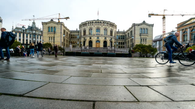 t/l people walking at downtown oslo, norway in autumn season - parliament building stock videos & royalty-free footage