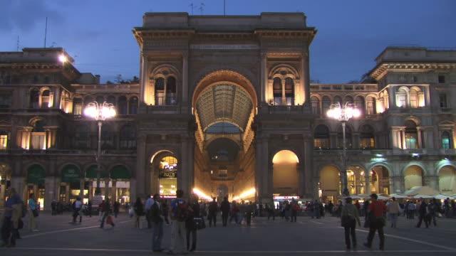 zo, ms, people walking at galleria vittorio emanuele ii at dusk, piazza del duomo, milan, lombardy, italy - piazza del duomo milan stock videos and b-roll footage