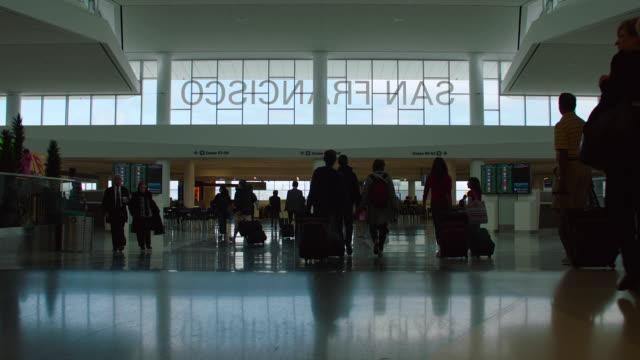 ms people walking at gate in sf0 - san francisco international airport stock videos & royalty-free footage